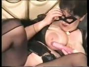 lady squirt nylons and a mask