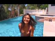 Asian babe with perfect tits gives black guy head in the pool