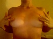 She plays with her nipples and lactates