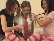 Three coed schoolgirls playing