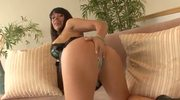 Busty brunette pornstar performs a hot solo