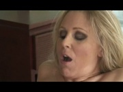 Milf works on top of the guy