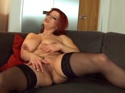 Mature redhead fills her pussy with hard meat