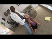Mature blonde handling a black dude