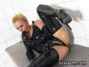 Blonde Wearing Latex Sucking A Cock