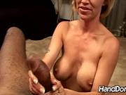 Mature gives huge black dong handjob