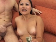 Adorable asian working hard for some cash
