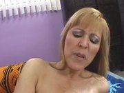 Big breasted wifey sits on a big cock
