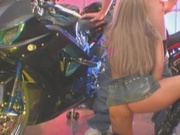 Hot babe fucked in motorcycle show