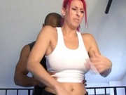 Hottie with red hair works out with a black guy
