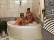 Lesbians making out in the bathtub