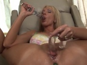 Busty mom plugs a massive dildo in her pussy