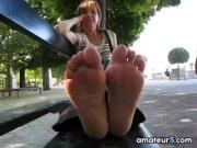Mature Feet On A Bench Outside