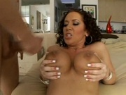 Big breasted milf catching cum on her tits