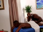 Ebony muscled masseur rims and sucks client