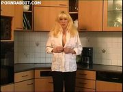 Mature blonde masturbates in the kitchen
