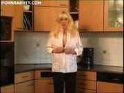 Mature blonde masturbates in the kitchen