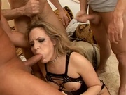 Gorgeous female swarmed by hard cocks here