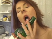 Horny mom sicking bottle neck in her pussy