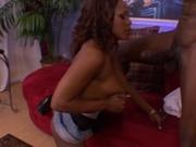 Pretty black woman handling two black cock