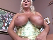Mom with massive tits sits on a cock