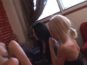 Three lesbians enjoying a strap on dildo