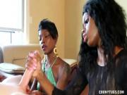 Ebony babes in threeway tugging on white cock