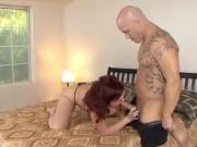mature brunette enjoying younger guys cock
