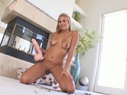 Horny girl fits a massive dildo in her cunt