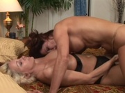Two busty milf fingering and licking pussies