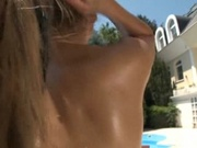 Busty babe fucked in the ass by the pool