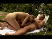 Amateur milf having sex with a guy in the garden