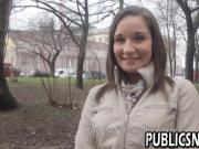 Skinny brunette flashes her tits in public