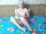 Cute short-haired blonde fingers both holes between her legs lying and standing doggy style.avi