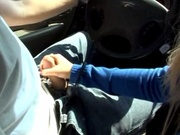 Lovely girlfriend jerking off her boyfriend in car