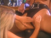 Two stunning babes having sex in the bar
