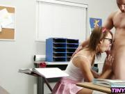Petite teen schoolgirl with glasses fucking in the classroom