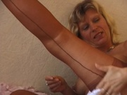 Mature woman plugging a massive dido in her pussy
