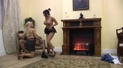 Two girls banging a guy near the fireplace