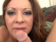 Tanned mommy loving a stiff cock