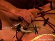 Eric Michaels balls squeezed by clamps while clothespins are plac