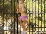bony Ivana teen playing in backyard