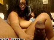 Chubby black babe gives bored handjob