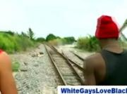 Interracial cock loving black guy give white guy a blowjob outdoo