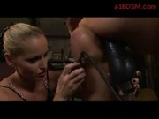 Bondaged Girl Standing On One Leg Mouth And Pussy Fucked With Pump Dildo By Mistress In The Workshop