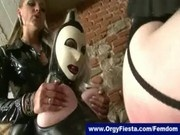 Sissy guy in latex ass fucked with strapon by mistresses