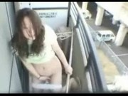 Asian Girl Masturbates on Balcony
