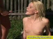 Blonde washes cum off her face with piss after outdoor fucksome
