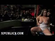 Busty brunette blowjob in bar