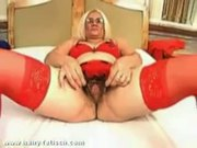 Hairy mature woman in red stockings fuck with black bo